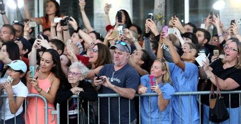 senior-woman-living-in-moment-no-smartphone-celebrities-movie-premiere-black-mass-2